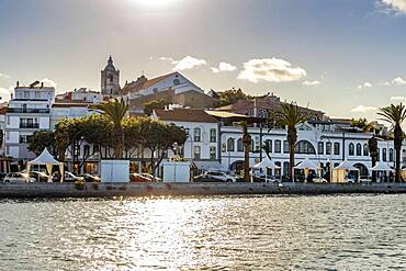 Old architecture facing wide river in historic Lagos, Algarve, Portugal, Europe