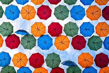 Umbrellas over shopping street, Drottninggatan, Stockholm, Sweden, Europe