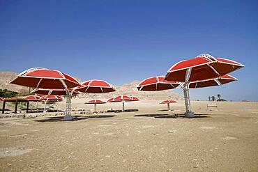 Abandoned parasols on the beach, Dead Sea, En Gedi, Negev desert, Israel, Asia