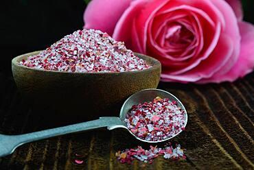 Rose salt in bowl and spoon, rose petal salt, Germany, Europe