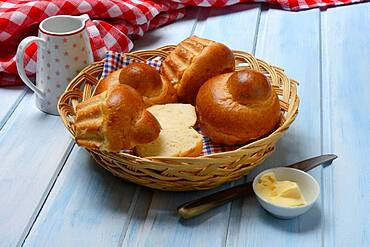 Brioche, brioches in basket and dish with butter, Germany, Europe