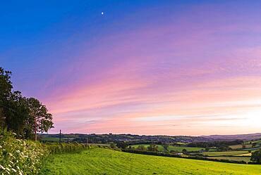 Sunset over Totnes fields, Berry Pomeroy Village, Devon, England, United Kingdom, Europe