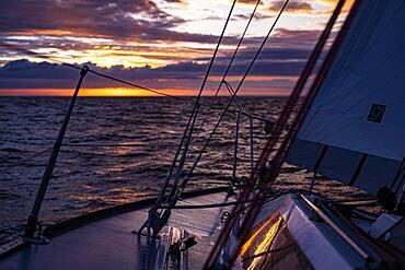 North Sea sailing on a half-tonner at sunset