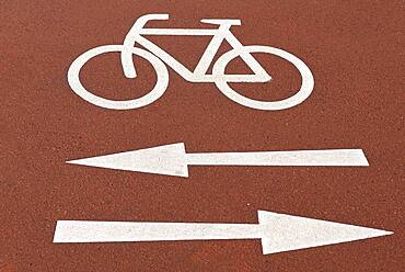 Red bike path with markings, Bavaria, Germany, Europe