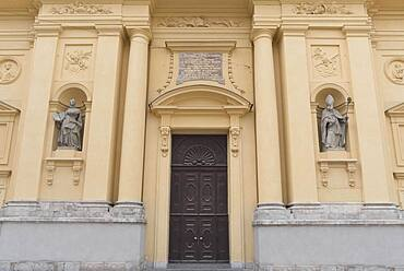 Two sculptures of saints on the main facade of the Theatine Church, Munich, Bavaria, Germany, Europe