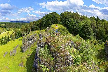Aerial view of the rock above Oberailsfeld with cyclist figure, called Claudius, Oberailsfeld, Franconian church village, district of Ahorntal, Ailsbachtal, Franconian, Franconian Alb, Upper Franconia, Franconia, Bavaria, Germany, Europe