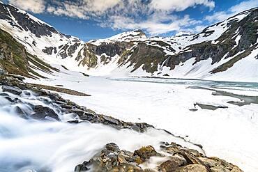 Mountain lake, partly frozen, Grossglockner High Alpine Road, Hohe Tauern National Park, Carinthia, Austria, Europe