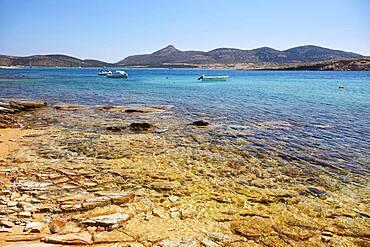 Golden shimmering beach in Antiparos with view of Despotiko, Antiparos, Cyclades, Greece, Europe
