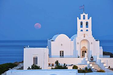 Full moon behind the monastery Chrisopigi on Sifnos, Cyclades, Greece, Europe
