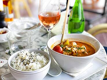 Asian soup in coconut sauce with shrimp and fish with rice, Port Andratx, Majorca, Spain, Europe