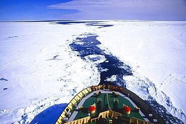 Russian Icebreaker Kapitan Khlebnikov making its way in the frozen sea near Atka Iceport or Atka Bay, Weddell Sea, Antarctica
