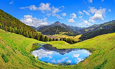 Alpine meadow with small lake and reflection, Partischalm, Nauders, Tyrol, Austria, Europe