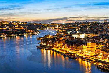 Skyline of the historic city of Porto with famous bridge at night in Portugal