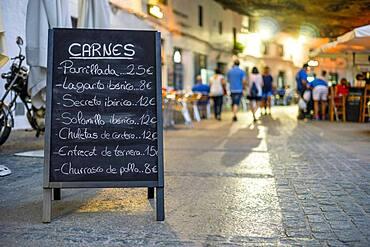 Menu of the meats of restaurant in the sidewalk of Setenil de las Bodegas, Andalucia, Spain, Europe