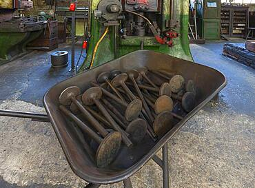 Car valves in the raw state in a wheelbarrow in front of a screw press in a drop forge, Industrial Museum, Lauf an der Pegnitz, Middle Franconia, Bavaria, Germany, Europe