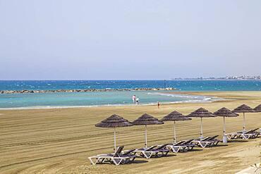 Deck chairs, straw umbrellas, empty beach, Robinson Club Cyprus, Alaminos, Cyprus, Europe