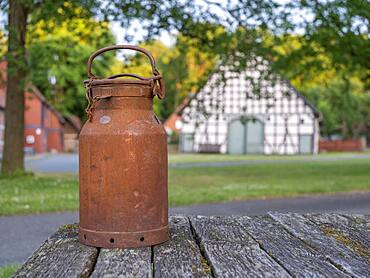 Old milk can in the village center of the Rundlingsdorf Luebeln, county Luechow-Dannenberg, Wendland, Lower Saxony, Germany, Europe