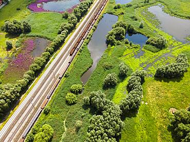Drone image of railway tracks and wetland near Klein Ilsede, Ilsede, Peine district, Lower Saxony, Germany, Europe