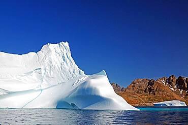 Smooth icebergs, Barren mountains, Summer, Arctic, Tasilaq, Greenland, Denmark, North America