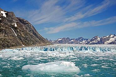 Pieces of ice in front of glacier, barren mountains, Knud Rasmussen Glacier, Tasilaq, Greenland, Denmark, North America