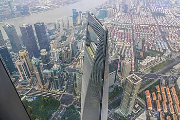 View from the highest observatory of the world on 562 meters height in the 632 meters high skyscraper Shanghai Tower to the special economic zone Pudong with the 492 meters high Shanghai World Financial Center, nicknamed The Bottle Opener, Shanghai, People's Republic of China