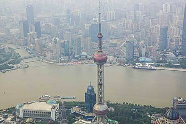 View from the highest observatory of the world on 562 meters height in the 632 meters high skyscraper Shanghai Tower on the special economic zone Pudong with the 468 meters high Oriental Pearl Tower the Huangpu River and the district Tilanqiao, Shanghai, People's Republic of China