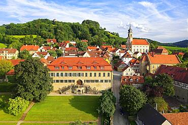 Village centre wine village Castell, castle Castell, early baroque, on the top right county church St. Johannes, behind it vineyard Schlossberg with stair tower old castle, near Wiesentheid, Steigerwald, Lower Franconia, Franconia, Bavaria, Germany, Europe