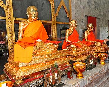 Statues of monks covered with gold leaf in Buddhist temple, Wat Chalong Buddhist monastery, Phuket island, Thailand, Asia