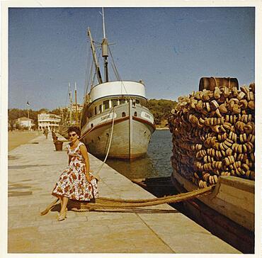 Yugoslavia in 1957, young German tourist posing in the harbour of the island of Rab, Adriatic Sea, Croatia, Europe