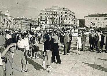 Yugoslavia in 1959: People at the harbour of Rijeka, in the back building of the shipping company Transjug, Adriatic Sea, Croatia, Europe