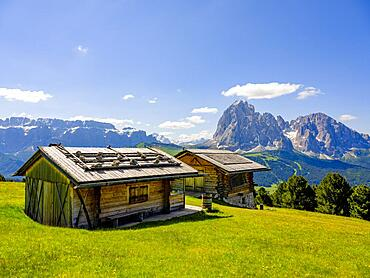 Alpine huts, Sella Group and Sassolungo in the background, Dolomites, South Tyrol, Italy, Europe