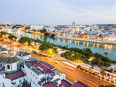 Aerial view of historic part with the river in Seville by the evening, Andalusia, Spain, Europe