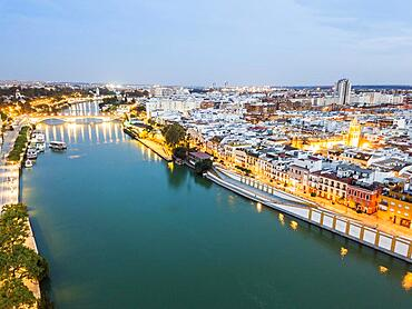 Aerial view of historic part with the river in Seville by the evening, Spain, Europe
