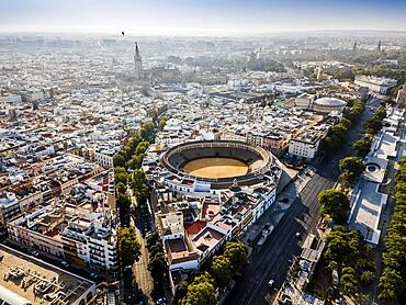 Aerial view of Seville with visible bullring and cathedral tower, Andalusia, Spain, Europe