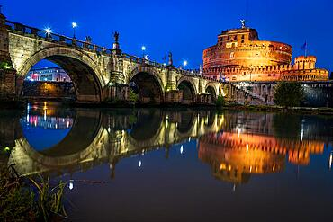 Bridge of Angels and Castel Sant'Angelo, blue hour, reflection in the Tieber, Rome, Italy, Europe
