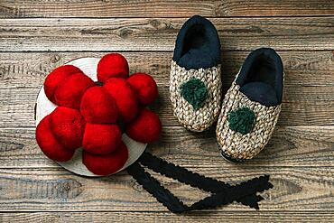 Original Black Forest Bollen hat with straw shoes on wooden background, Black Forest, Baden-Wuerttemberg, Germany, Europe