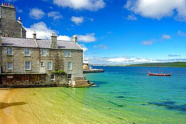 Quiet bay with crystal clear water, harbour, stone house and Viking ship, Lerwick, Shetland Islands, Scotland, United Kingdom, Europe