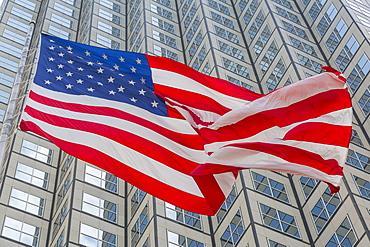 American flag set against skyscraper building windows in Downtown Miami, Miami, Florida, United States of America, North America