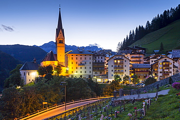 Church and village of Pieve Di Livinallongo at dusk, Province of Belluno, Dolomites, Italy, Europe