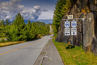View of The Sea to Sky Highway and signpost near Squamish, British Columbia, Canada, North America