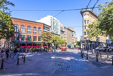 Architecture, trolleybus and cafe bar in Maple Tree Square in Gastown, Vancouver, British Columbia, Canada, North America