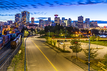 View of city skyline and Vancouver Lookout Tower at dusk from Portside, Vancouver, British Columbia, Canada, North America