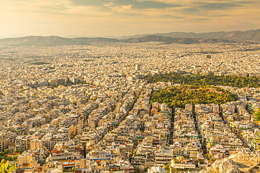 View of North Athens suburbs from Likavitos Hill in late afternoon, Athens, Greece, Europe