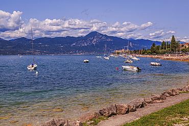View of boats on Lake Garda from near Albisano, Lake Garda, Veneto, Italian Lakes, Italy, Europe