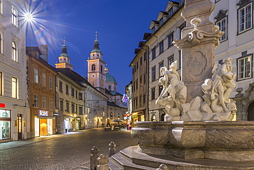 View of Cathedral of St. Nicholas and Robba fountain at dusk, Ljubljana, Slovenia, Europe