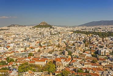 View of Athens and Likavitos Hill over the rooftops of the Plaka District from The Acropolis, Athens, Greece, Europe