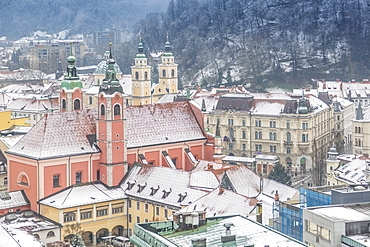 View of snow covered Franciscan Church of the Annunciation from The Skyscraper, Ljubljana, Slovenia, Europe