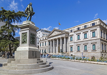 View of Michaeli de Gervantes statue and Congress in Plaza de las Cortes, Madrid, Spain, Europe