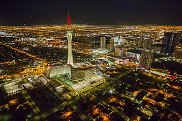 View of Las Vegas and Stratosphere Tower from helicopter at night, Las Vegas, Nevada, United States of America, North America