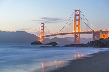 View of Golden Gate Bridge from Baker Beach at dusk, South Bay, San Francisco, California, United States of America, North America